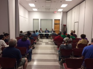 More than 50 people attended the Aug. 15, 2017, panel discussion on Arkansas' new law allowing concealed weapons to be carried on campuses statewide. The session was held at St. Paul's Episcopal Church in Fayetteville and featured officials of the University of Arkansas.