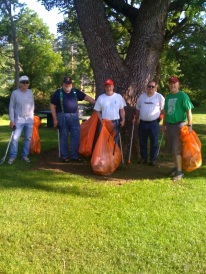 Civic work, picking up trash at one of the city parks outdoor
