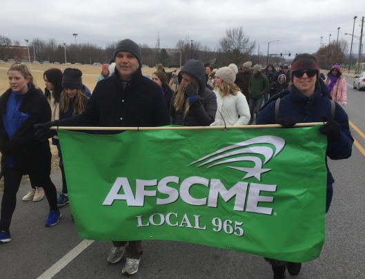 Mike Pierce and Tricia Starks represent AFSCME Local 965 at Fayetteville's Martin Luther King Jr. march Jan. 15, 2018.