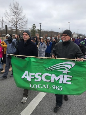Mike Pierce (left) and Ted Swedenburg represent AFSCME Local 965 at Fayetteville's Martin Luther King Jr. march Jan. 15, 2018.