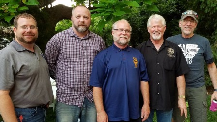 Clint Morris (from left), Donald McKinney, Bruce Appel, Alan Hughes and Hershey Garner pose May 31, 2018, at the annual barbecue of the Northwest Arkansas Labor Council, held at Martin Law Firm in Fayetteville.