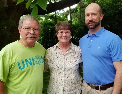 Walter Hinojosa (from left) Betty Martin and her son Aaron Martin enjoy the Northwest Arkansas Labor Council annual barbecue, at Martin Law Firm in Fayetteville, May 31, 2018. Hinojosa is president of the Northwest Arkanss Joint Labor Council. Betty Martin is a trustee and past president of Local 965 of the American Federation of State, County and Municipal Employees. Aaron Martin, an attorney, is a member of the Office and Professional Employees International Union.