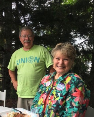 Walter Hinojosa and Denise Garner picnic May 31, 2018, at the annual Northwest Arkansas Joint Labor Council barbecue, held at Martin Law Firm in Fayetteville. Hinojosa is president of the area labor council. Garner is the Democratic nominee for District 84 of the Arkansas House of Representatives.