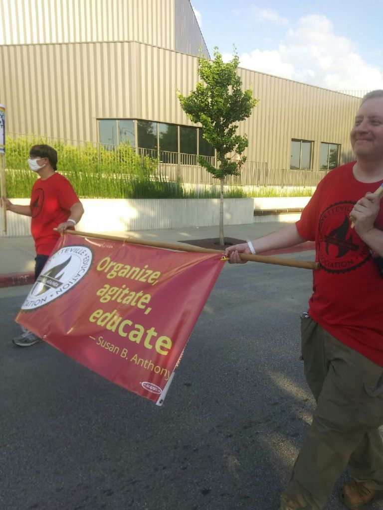 Local 965 at-large board members Ryan Gliszinski and Chad Kieffer participate in the Fayetteville Trans March on June 24.